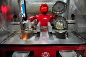"Robot Restaurant: A 'chef' robot prepares ""jiaozi"", or Chinese dumplings"
