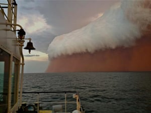 A towering red dust storm