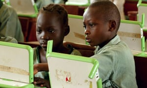 Nigerian pupils work on computers at the LEA primary school in Abuja