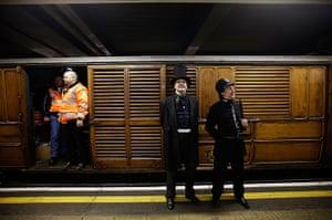 Met locomotive: Actors in period costume with underground workers