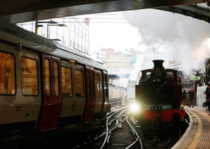 Met locomotive: A steam train passes a tube train as it enters Farringdon Station
