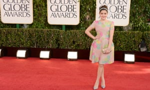 Modern Family star Ariel Winter poses on the red carpet at the Golden Globe awards.