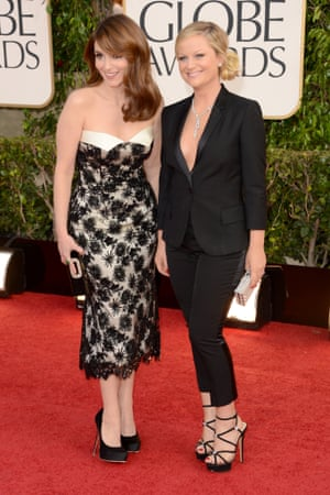 Hosts Tina Fey and Amy Poehler arrive for the 2013 Golden Globes in Los Angeles.