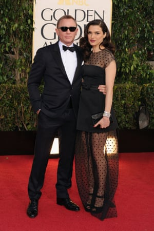 Daniel Craig and Rachel Weisz pose for photographs on the red carpet before the 2013 Golden Globes awards in Los Angeles.