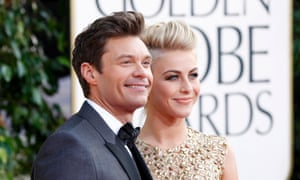 Red carpet host Ryan Seacrest and actor Julianne Hough arrive at the Golden Globes.