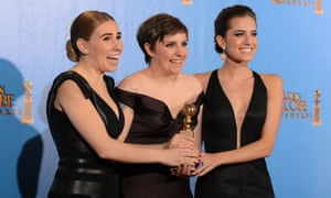 Lena Dunham, centre, poses in the Golden Globes press room with Girls co-stars Zosia Mamet, left, and Allison Williams.
