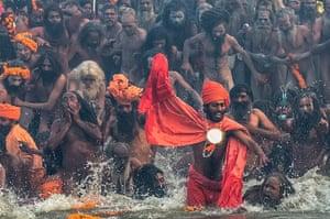 Kumbh Mela: Naga sadhus run in to bathe in the watersd