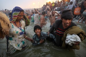 Kumbh Mela: An Indian Hindu boy is reluctantly guided by his parents