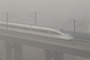 Air Pollution in China: A high-speed railway runs amid heavy fog in Xuchang, China's Henan Province