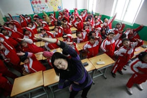 Air Pollution in China: body exercise during class break in a classroom on a foggy day in Jinan