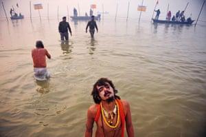 Kumbh Mela: A Hindu Sadhu or Holy Man closes his eyes