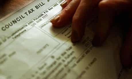 A pensioner examines her council tax bill