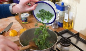 Felicity Cloake making dal with kale in her kitchen.