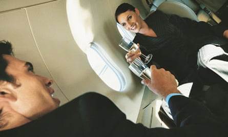 Business people celebrating on aeroplane