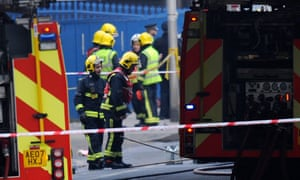Police and firemen are seen at the site of a helicopter crash in Vauxhall, London.