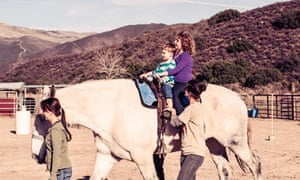 Janni riding with her brother Bodhi