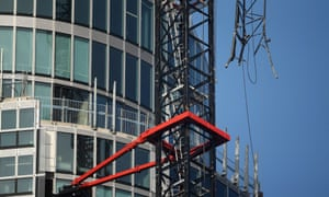 A damaged crane attached to St Georges Wharf Tower after a helicopter collided with it, in Vauxhall, London.