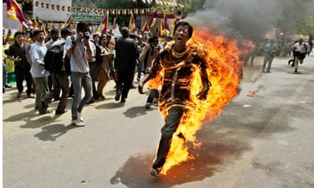 Tibetan man in flames at a protest in New Delhi, India, 2012