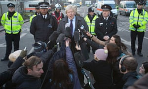 London mayor Boris Johnson speaks to the media after attending the scene of a crashed helicopter in Vauxhall, London January 16, 2013. REUTERS/Neil Hall (BRITAIN - Tags: DISASTER POLITICS) :rel:d:bm:LM1E91G1ACZ01