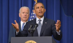 Obama speaks on proposals to reduce gun violence as vice president Joe Biden watches at the White House.