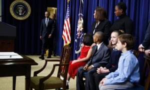 Children and the families of children who wrote to the president after the Newtown massacre watch Barack Obama arrive for the gun control announcement.