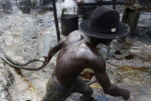 from the agencies: Illegal oil refinery in Nigeria by Akintunde Akinleye