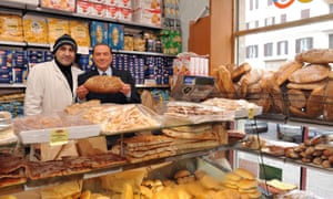 Former Italian prime minister Silvio Berlusconi posing with a baker in Rome this week.
