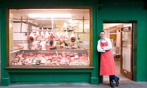 A traditional English butcher outside his shop