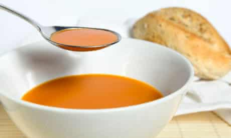 A spoonful of tomato soup from a bowl