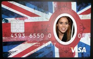 Berlin visit: Princess Beatrice of York peers through a giant credit card