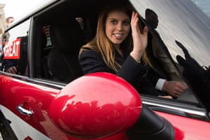 Berlin visit: Princess Beatrice waves as she sits in a BMW Mini