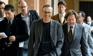 Italian sports doctor Michele Ferrari (C) leaves the Bologna's tribunal followed by journalists and his lawyer Dario Bolognesi (R), 01 October 2004.