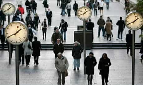 people walk by clocks