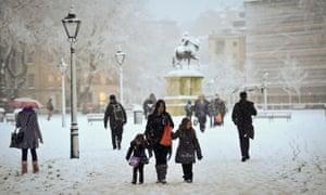 People walk through Queens Square in Bristol.