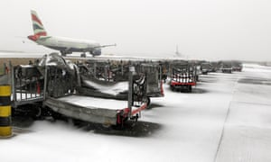 A plane sits on the runway at Heathrow airport, as Britain s transport network began to buckle today as heavy snow swept the UK.