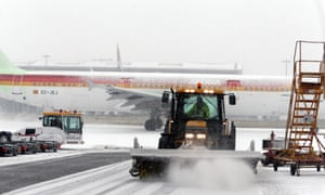 A snow plough clears snow from Heathrow Airport.