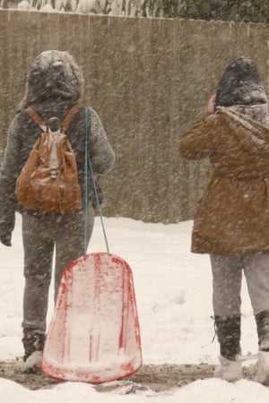 Children enjoy the snow in Emmer Green, Reading