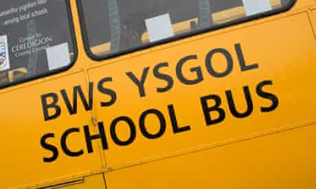 Bilingual Welsh and English signs on a school bus.