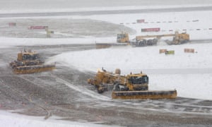 Snow ploughs at Gatwick Airport clear the runway, airfield and surrounding areas to keep the airport open, as Britain s transport network began to buckle today as heavy snow swept the UK.
