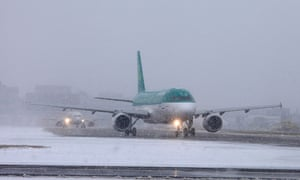 Planes wait on the runway at Gatwick Airport, as Britain s transport network began to buckle today as heavy snow swept the UK.