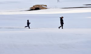 People walk on St Andrews Golf Course on January 18, 2013 in St Andrews, Scotland.