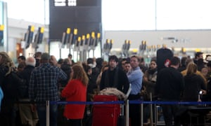 Passengers waiting to rebooked their flights in Terminal 5 at Heathrow airport as some flights have been cancelled due to bad weather