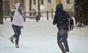 People have a snow ball fight in Bristol , as snow shut roads and disrupted train travel today but the major commuter belt areas of southern England escaped the worst of the morning hazards.