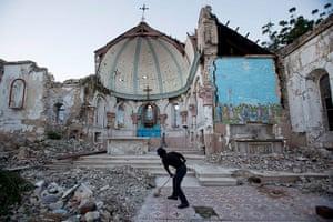 20 Photos: A man sweeps in the earthquake-damaged Santa Ana church in Port-au-Prince