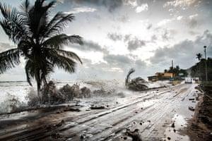 20 Photos: Waves hit the road along the sea near Ca