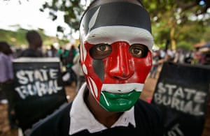 20 Photos: In Nairobi, a demonstrator wears a mask in the colors of the Kenyan flag