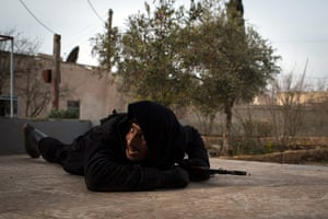 20 Photos: A Rebel fighter ducks for cover from government jet fighters in Syria