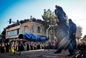 20 Photos: An Iranian officer lashes a man, convicted of rape, in  Sabzevar, Iran