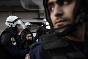 20 Photos: A protestor is arrested by riot policemen during a demonstration in Manama