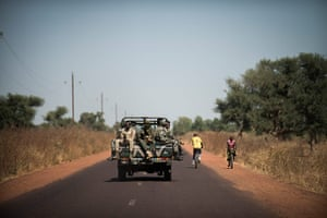 20 Photos: Malian soldiers sit in a pick up on their way to Niono